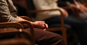 Close-up of a woman's hands in prayer at Capuchin Retreat