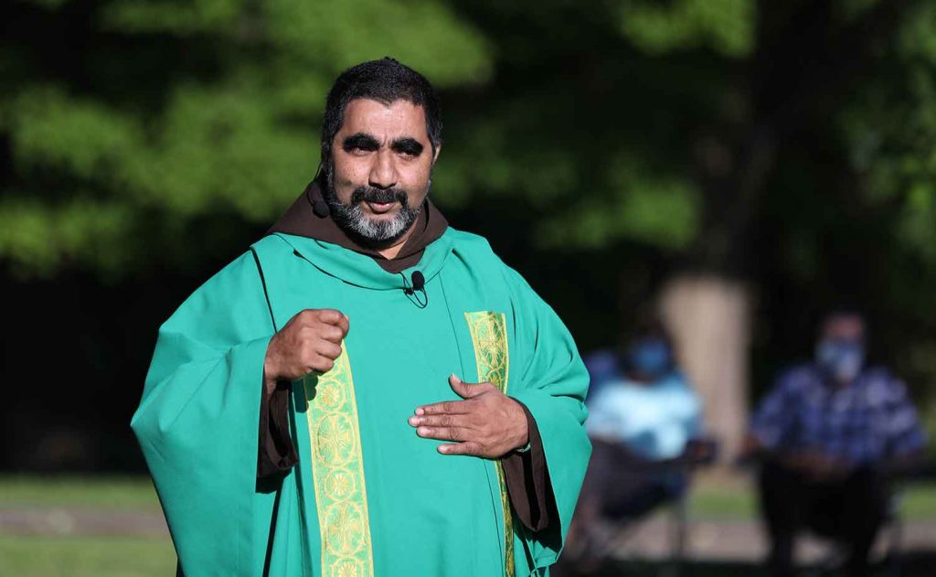 Fr. Biju preaches at outdoor Mass