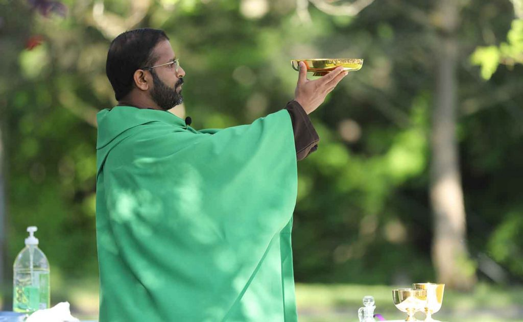 Fr. Binoy at the liturgy of the Eucharist