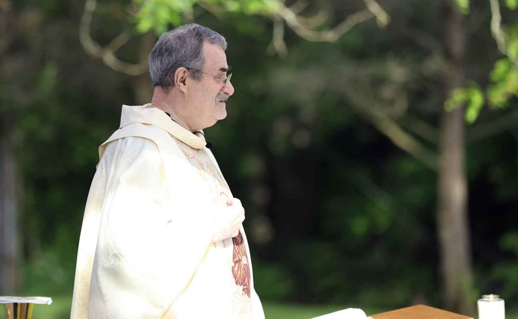 Fr. Jim Hast preaches at outdoor Mass