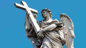 Photograph of an angel holding a cross