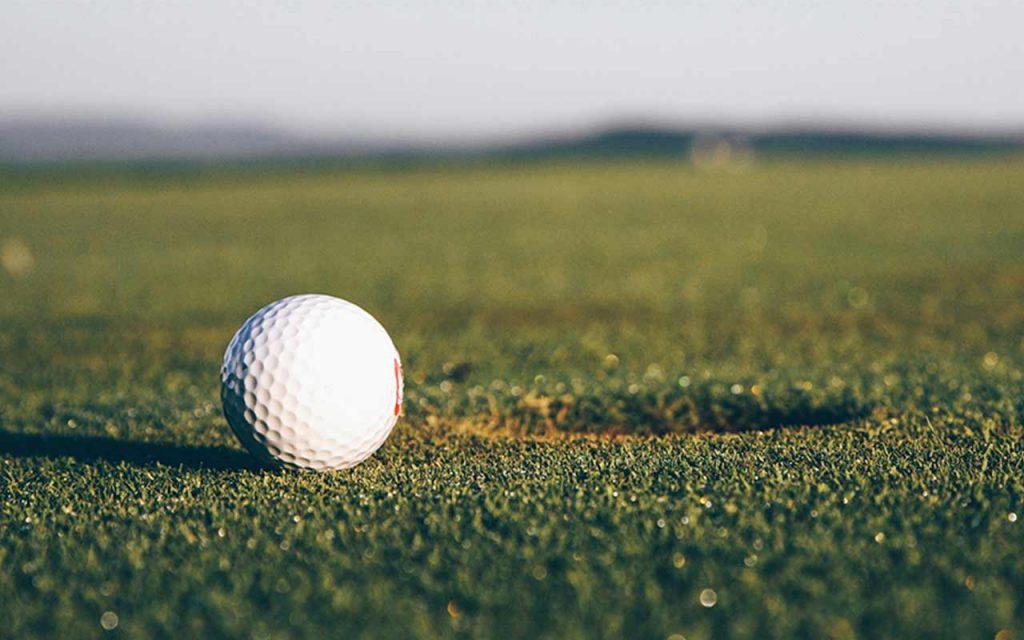 Photo of golf ball near hole